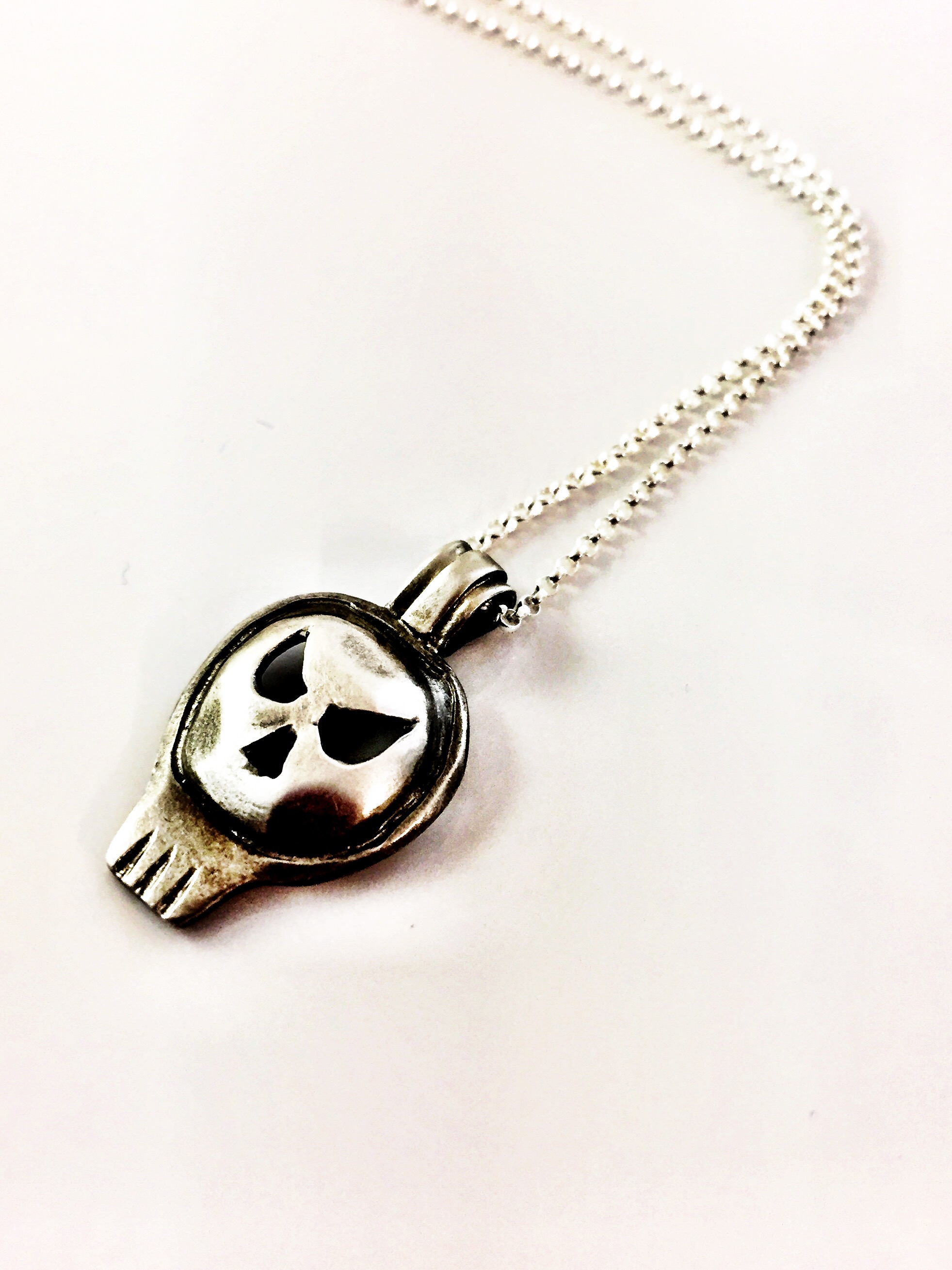 Fine silver hand sculpted skull necklace on sterling silver chain