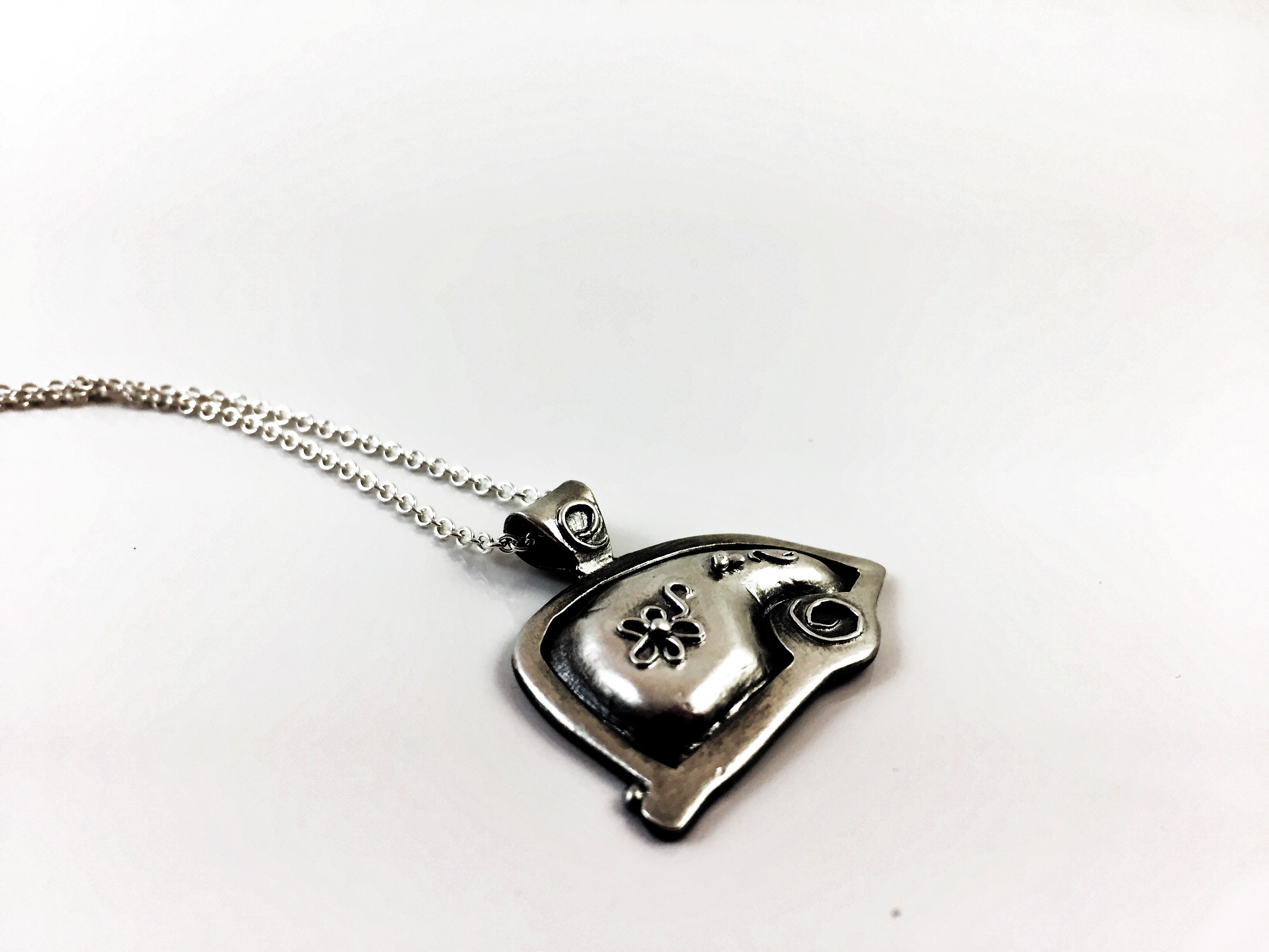 Fine silver hand sculpted teardrop trailer necklace on sterling silver chain